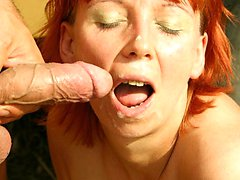 redhead eating cum outside