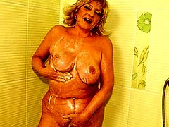 This horny housewife loves playing in the shower