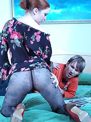 Awesome milf in patterned pantyhose teasing a guy with her spreading legs