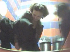 Unsuspecting hotties busted watering in toilet