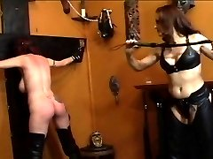 Cute redhead gets dominated by redhead in black leather