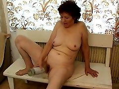Crazy old lady loves vodka so much she is ready to fuck her pussy with a bottle!