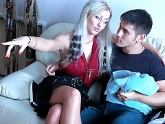 Sizzling hot chick talks a guy into strap-on domination games on the sofa