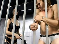 Nasty dominatrix Leah Wilde bounds her naked slave to a prison cell bar and flags him in this...