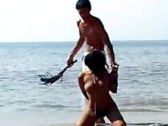 Handsome bigcocked man schools, lashes and fucks hot chick on a beautiful ocean beach