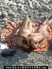 Nude beach couple please use their hands for fun