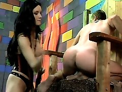 Sexy domme Leah Wilde punishes her male submissive partner by inflicting pain with her whip