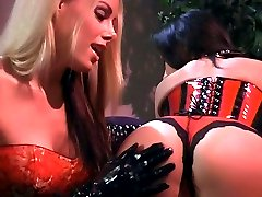 Lesbian spanking scene with Nicole Sheridan and Alaura Eden treating each other with OTK spanking