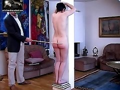 Raven haired beautys naked caning - well welted cheeks