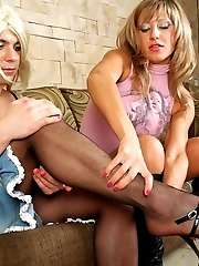 Frisky girl brings some female clothes and strap-on fucks her sissy friend