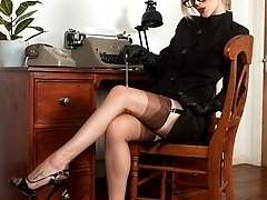 Michelle in prim suit, vintage nylons and sheer panties!