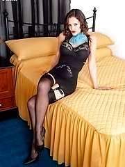 On towering stilettos she strips and gets herself aroused, nylon legs splayed wide for her to...