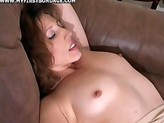 Stunning brunette is tied, teased and fucked by her lover