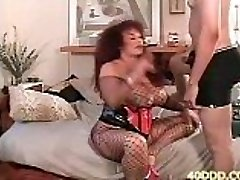Ebony bombshell Vanilla in a white tank top while getting anal fucked in a sofa