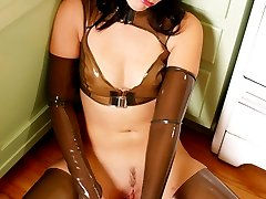 Latex clad fetish vixen cooking in the kitchen