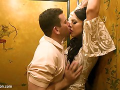 The stunning Chanel Santini returns to the Hotel Majestic, this time moving in on Reed Jameson, an unsuspecting bar patron who mistakes her for another woman. In no time they're upstairs, with hands and mouths all over each other in a hot, heavy, sweaty flip fuck. Chanel sucks Reed's cock and gets him rock hard before she lets him worship her like it's his dream come true. He eats her perfect ass and sucks her thick hard cock, choking on it as it pumps in his throat. Chanel uses Reed for her every pleasure, taking him in her gorgeous ass and then fucking him with her hard, dripping cock. While she's pounding him he shoots his load, then she unloads immediately after, topping off an unexpected but explosive afternoon!