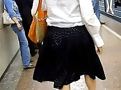 Nice lady in black skirt doesnt notice the guy shooting her panties