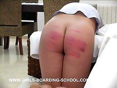 Misbehaving girl caned hard bent over the settee - deep red stripes