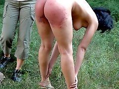Two naughty girls spanked hard with their knickers pulled tight up their ass crack
