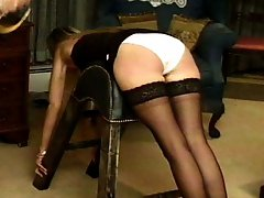 Three young women caned by their English mistress, some with panties, some without.  She seems to enjoy her work as most mistresses do.
