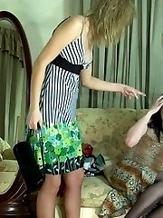 Sultry strap-on armed gal in red nylons showing sissy guy who has the power