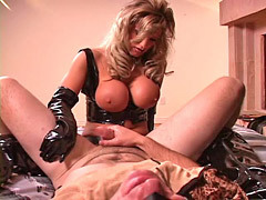 Alluring domina in black latex hard fucking sissy's ass with a strapon dildo