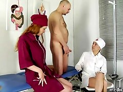Milking a naked submissive man in the femdom consulting room