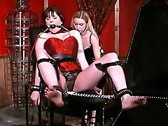 Mistress Erzsebet ball gags and binds her slave Alsara Sin while inflicting pain in this BDSM story