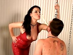 Femdom scene with Mistress Anastasia Pierce inflicting pain to her malesub by dripping hot wax...