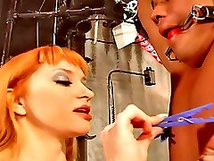 Smoking redhead mistress pinching slaves nipples, cock and balls with pins