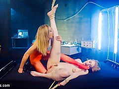 Sexy mad scientist (Mona Wales) clones herself, creating a horny submissive sex toy (Ela Darling) to exercise her narcissistic lesbian desires with! Dressed in identical clothes with almost twin appearances, Mona seduces Ela, ass on glass, through the plexiglass walls of her incubator before spanking, flogging and finger banging her to orgasm while tied to the ceiling. Mona uses her clone for face sitting and vibrator scissoring and fucks her to multiple orgasms with pussy and anal strap-on fucking!