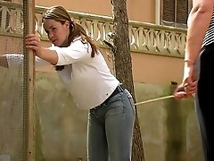 Misbehaving girl caned on her naked buttocks in the back yard - bruised and swollen cheeks