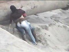 Latino couple caught on the beach
