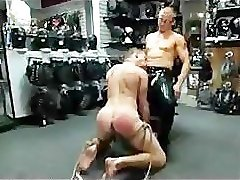 Bound gay sucks and jerks off dicks in leather shop