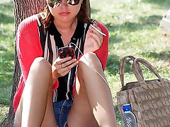 Girl under tree showing her upskirt
