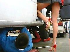 Mechanic fucks his busty boss in the office