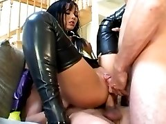 Pretty brunette in latex stockings fucking two guys