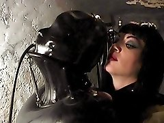 Latex slave gets spanked by her Crimson Mansion domme and fucked with a powerful orgasm machine