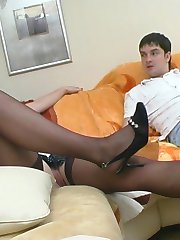 Seductive chick in black full fashioned stockings giving a hell of blowjob