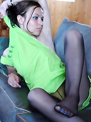 Stunning babe shows her nyloned feet while playing the game of billiards