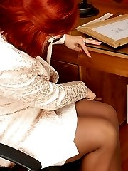 Redhead mature chick seducing her co-worker into outrageous pantyhose sex