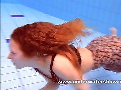 Redhead Katka playing underwater