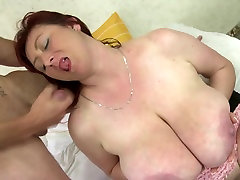 Mature mom with very big boobs takes young cock
