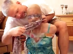 scarf tied with 2 pair of panties in mouth