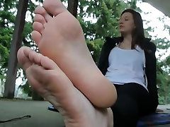 Teen showing her soft feet end soles