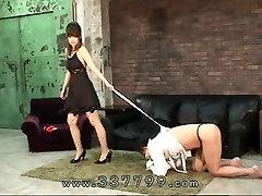 Japanese femdom Mayumi is dripping wax on the slaves penis.