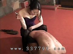 Japanese femdom erases cigarettes with slave body
