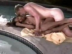 Beautiful ebony girl fucks a white guy poolside
