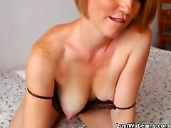 Ginger babe stuffs her pussy with panties on webcam