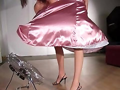 Elle Tyler wearing a pink satin dress